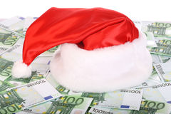 Santa Claus hat on euro. Close-up Stock Image