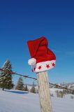 Santa Claus Hat on fence Royalty Free Stock Photos