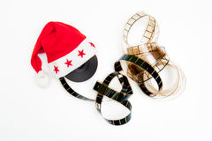 Santa Claus hat and film reel Stock Images