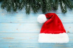 Santa claus hat with fir tree branches stock images