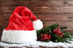 Santa claus hat and fir tree branches royalty free stock image
