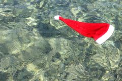 Santa Claus hat in tropical sea Stock Photos