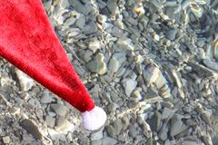Santa Claus hat in tropical sea Royalty Free Stock Photography