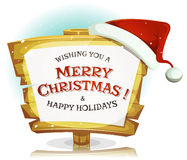 Santa Claus Hat On Funny Wood-Zeichen Stockfotos