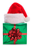 Santa Claus hat and gift wrapped present Stock Image