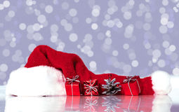 Santa Claus hat and gifts Royalty Free Stock Image