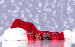 Santa Claus hat and gifts Royalty Free Stock Image