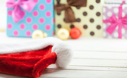 Santa Claus hat and gifts Stock Images