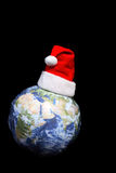 Santa Claus hat on globe Stock Photography