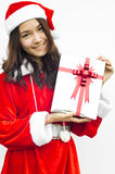 Santa claus hat with grey christmas gift box Stock Photos