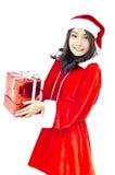 Santa claus hat with grey christmas gift box Royalty Free Stock Image