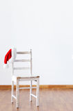 Santa claus hat hanging on empty wooden chair Stock Image