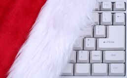 Santa Claus hat on keyboard royalty free stock images