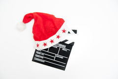Santa Claus hat on a movie clapper board. Isolated on white background Royalty Free Stock Images