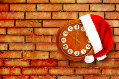 Santa Claus hat on New Year's night on the old clock Stock Images