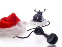 santa claus hat and old telephone stock photos