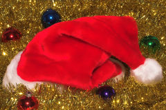 Santa Claus hat and ornaments Stock Image