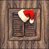Santa claus hat over wooden background. vintage style toned pict Royalty Free Stock Images