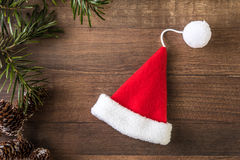 Santa Claus hat. With pine cones and a wooden background Stock Image