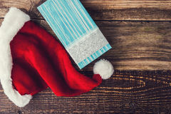 Santa Claus hat with present on the wooden table horizontal Stock Photography