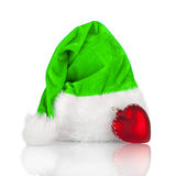 Santa Claus hat and red Christmas toy Royalty Free Stock Image