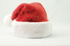 Santa Claus hat and snow Stock Image