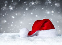 Santa Claus hat with snowfall Royalty Free Stock Photos
