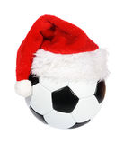 Santa Claus hat on the soccer ball Stock Image