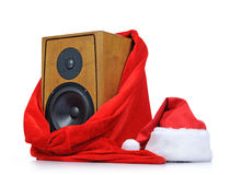 Santa Claus hat and speaker in the red bag on white background Stock Image