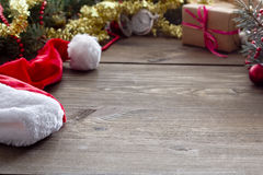 Santa Claus hat on the table, New Year`s gift stock photo