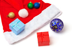 Santa Claus hat, toy bubbles and christmas gifts Royalty Free Stock Photo