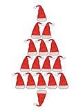 Santa Claus hat, tree. Christmas tree with Santa Claus hat royalty free stock photography