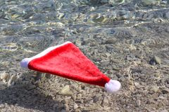 Santa Claus hat in tropical sea Stock Photo