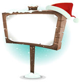 Santa Claus Hat On Wood Sign Royalty Free Stock Photos