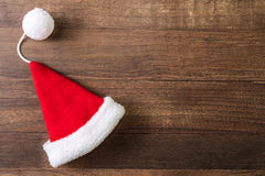 Santa Claus hat. On wooden background Royalty Free Stock Photos