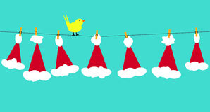 Santa claus hats on clothesline Stock Photography