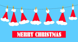 Santa claus hats on clothesline Royalty Free Stock Photography