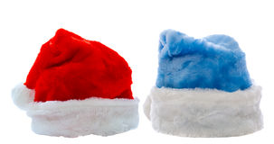 Santa Claus hats isolated over white Royalty Free Stock Photos