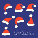 Santa Claus Hats Set Stockfotos