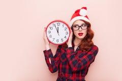 Santa Claus hatt med klockan Arkivfoton