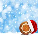 Santa Claus hatt och klocka Arkivbild