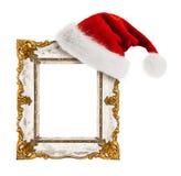 Santa Claus hatt som hängs på tappningramen Royaltyfri Fotografi