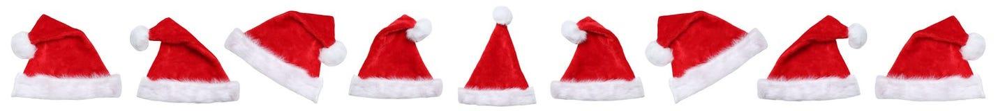 Santa Claus hatthattar på jul övervintrar i rad isolerat Arkivbild