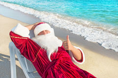 Santa Claus have e rest in chaise longue on sea beach Stock Image