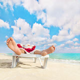 Santa Claus have e rest in chaise longue on sea beach Royalty Free Stock Image