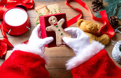 Santa Claus have wrapping a Christmas cookie Stock Images