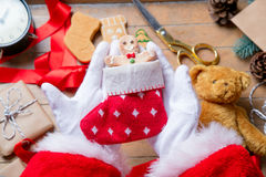 Santa Claus have wrapping a Christmas cookie Royalty Free Stock Photography