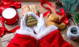 Santa Claus have wrapping a Christmas cookie Royalty Free Stock Image