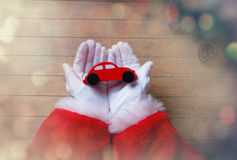 Santa Claus have wrapping a Christmas toy car Stock Photography