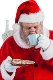 Santa claus having a cup of coffee Stock Images
